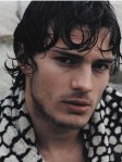 Jamie Dornan with long curly hairstyle with long curly bangs