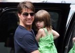 Tom Cruise with daughter Suri board a helicopter in NYC